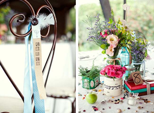 wrought iron chairback with blue ribbon and feather; Decor on wedding table.
