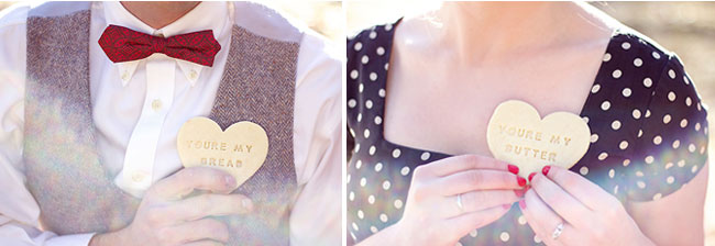"Groom holds heart shaped wood button that say, ""You're my bread"" and bride holds one that says, ""You're my Butter"""