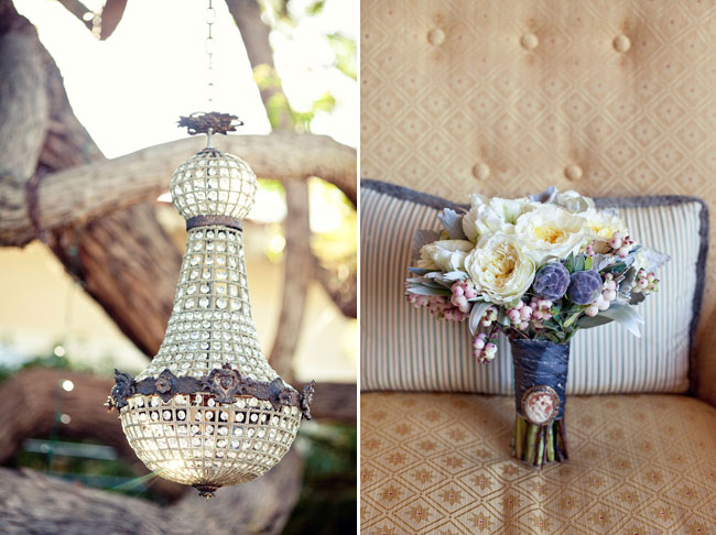 vintage chandelier hangs from tree, vintage brooch pinned to bouquet