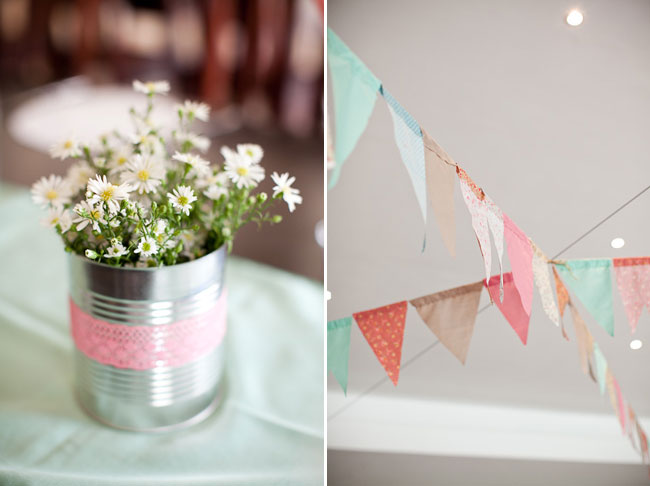tin can wrapped with pink lace holding white daisies