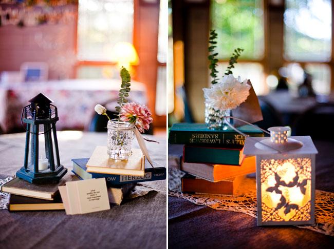 lanterns, old books, and mason jar centerpiece