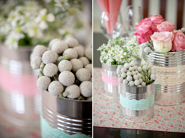 Tin cans with pin roses and white daisies