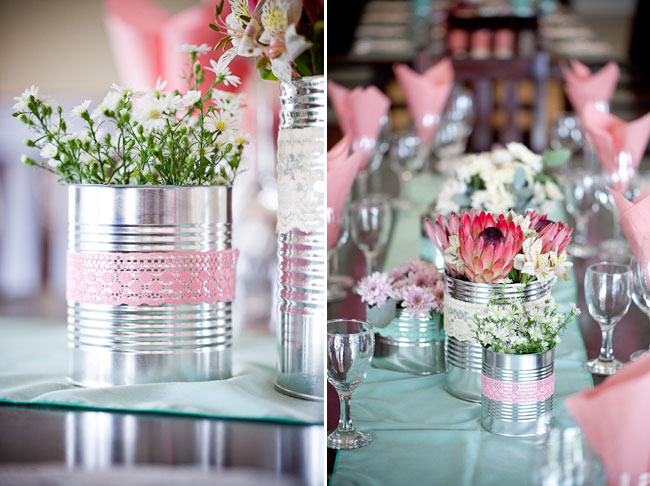 protea centerpiece in tin can wrapped with lace