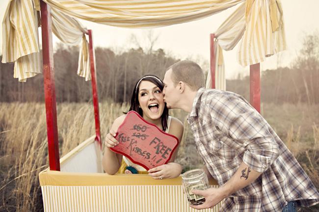Sharing a free kiss at the kissing booth