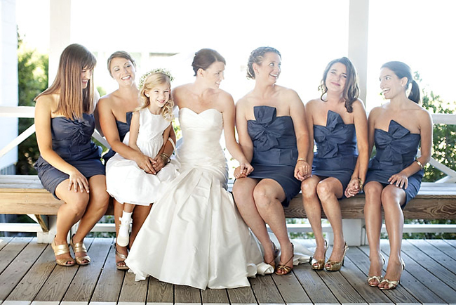 bridesmaids in J Crew navy blue dresses with big bow