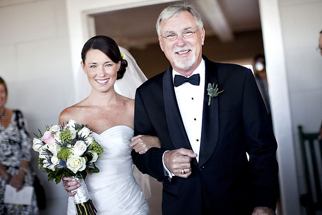 bride and father walk down aisle for wedding at the Carolina Yacht Club