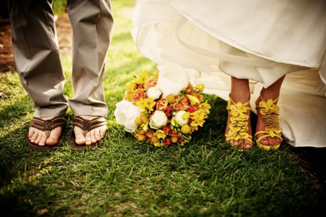 groom in sandals and bride in yellow heels for budget friendly Hawaiian wedding