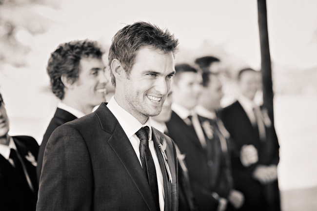 black and white photo of groom smiling
