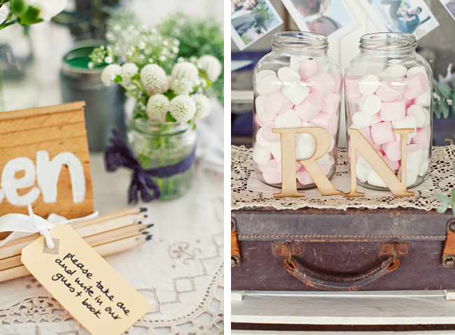 guest book pencils with tag, pink and white marshmellows in a jar on old suitcase