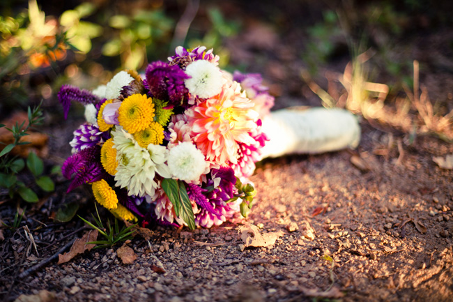 cheerful and colorful bridal bouquet on floor in the woods