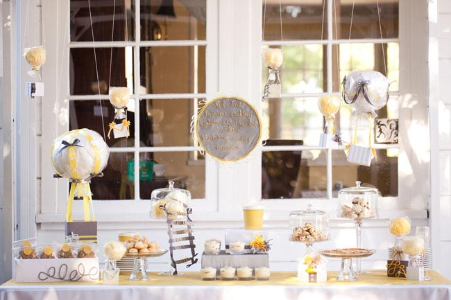 hot air balloon decor hanging over dessert table