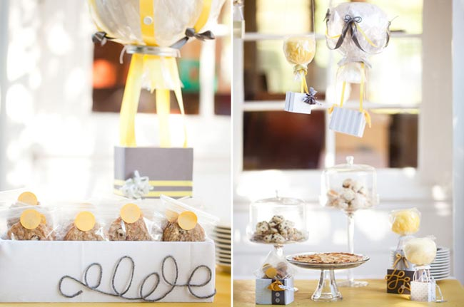 cotton candy hot air balloon treat hangs over dessert table