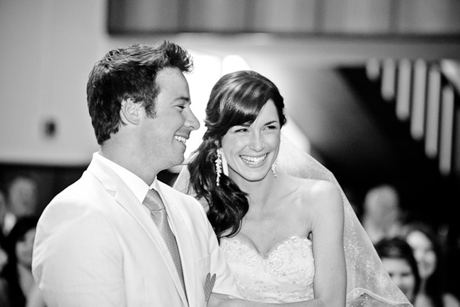 black and white photo of bride and groom at ceremony