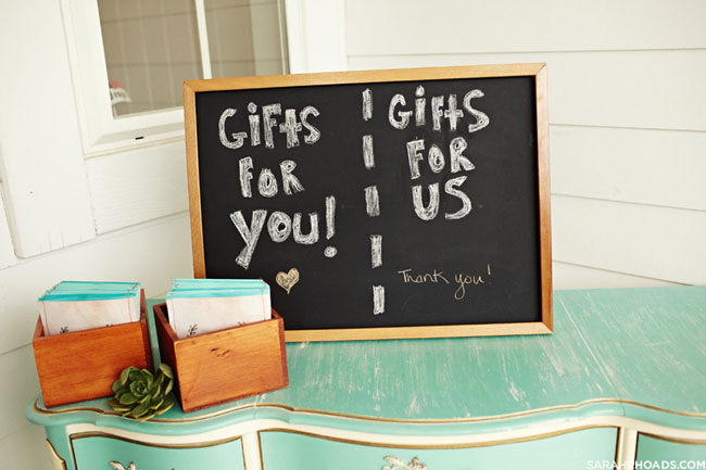 Vintage turquoise color gift table with chalkboard sign