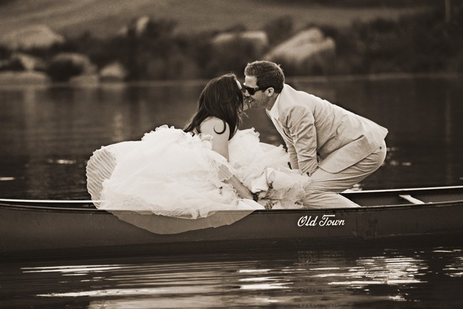 sharing a kiss in the canoe on the lake