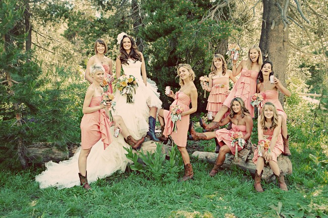 bridal party with peach colored dresses and boots