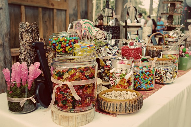 inside photo of log cabin wedding at a lake showing candy table