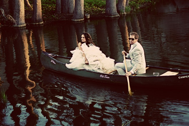 bride and groom in canoe on lake