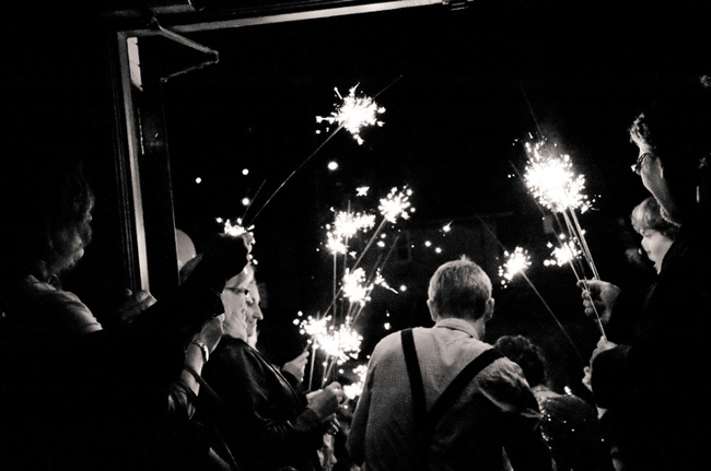 black and white photo of sparkler exit