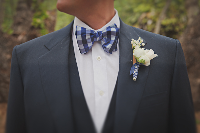 groom blue checkered bowtie with boutonniere