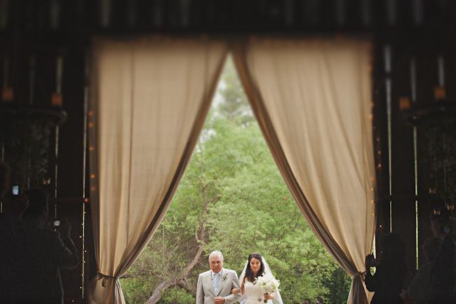 bride and father walking into ceremony at barn wedding in Ranchos Dos Pueblos