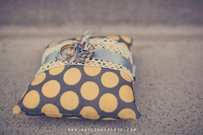 ring tied with bow to yellow polka dot pillow