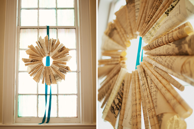 wreath made form sheet music hanging in window