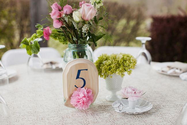 pink tissue paper table number and flower centerpiece