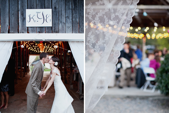 Newlyweds kiss at entrance to barn reception at Ashland Berry Farm