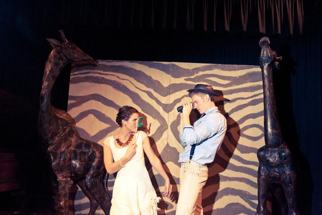 safari themed wedding photo backdrop with giraffes