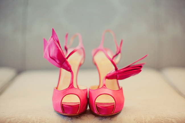 Bright pink peep toe pumps with tassle