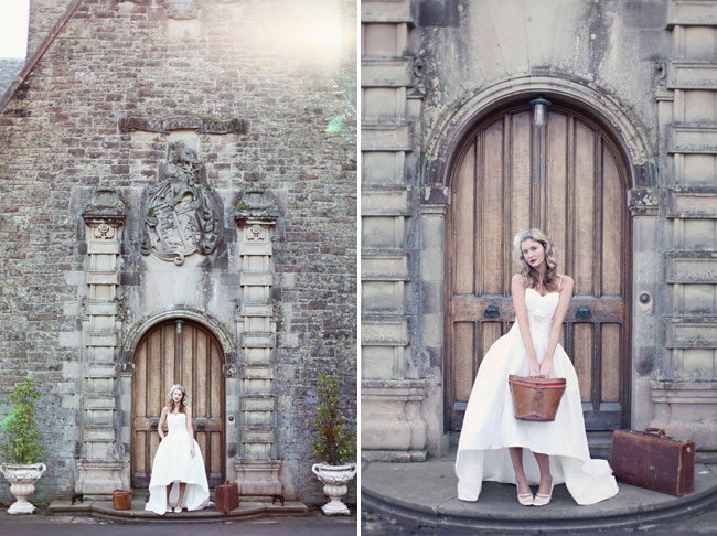 castle bridal shoot model holding leather basket in front of wood doors to Rowallan Castle