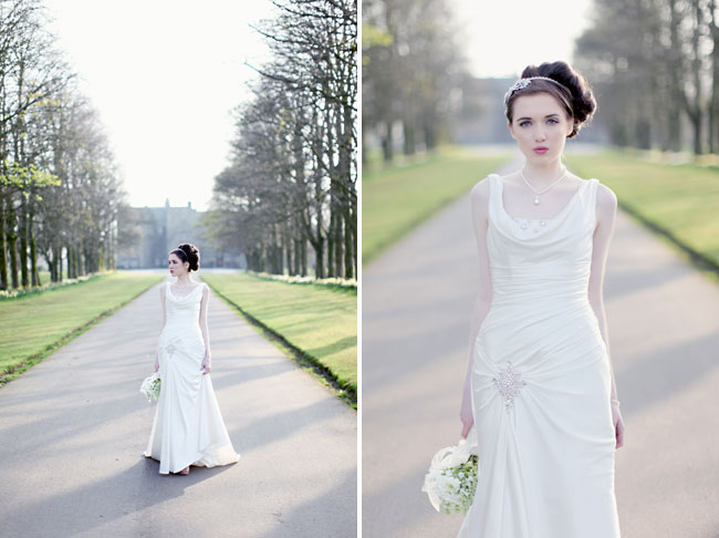 bridal photo shoot model stands on driveway to Rowallan castle holding bouquet
