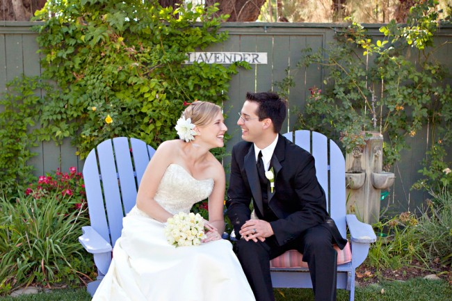 Bride and Groom in lavender color adirondacks for their wedding reception at The Lavender Inn,
