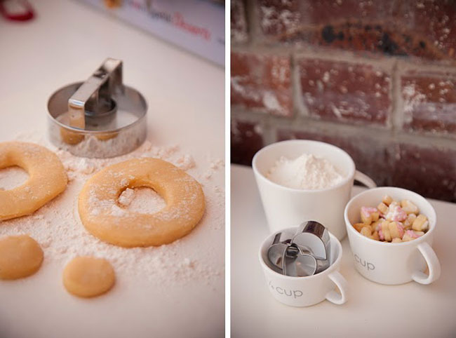 donut cutter with uncooked donuts on counter; photo of flower and cookie cutters inside white coffe mugs