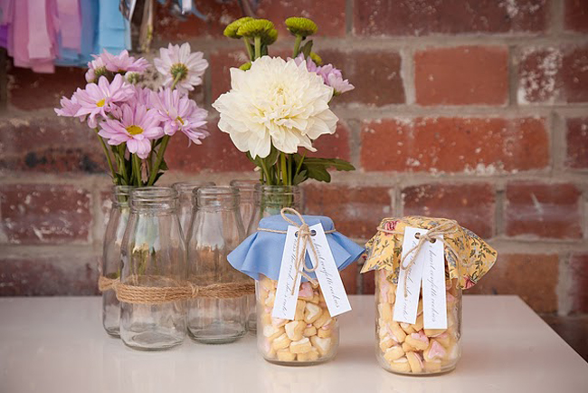 mason jars filled with mini shortbread cookies, brick wall background