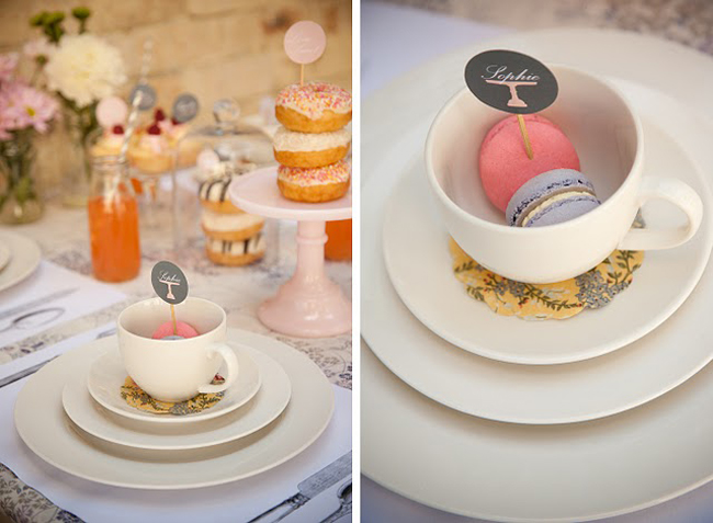 pink and lavender color macaroons inside white teacup