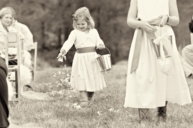 "black and white photo of flower girl at wedding ceremony at ""The Farm"" in Rome, GA"