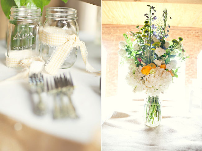 Mason jars with ribbon around, large flower bouquet in vase