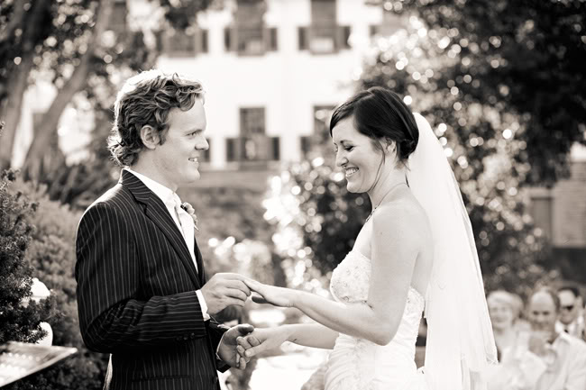 black and white photo of bride and groom during ceremony