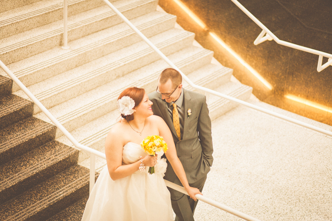 Bride and groom walk down steps at The Newark Club