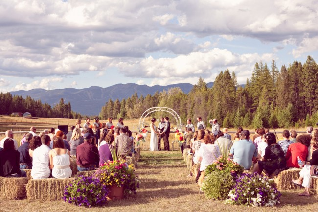 outdoor wedding ceremony with haybale seating