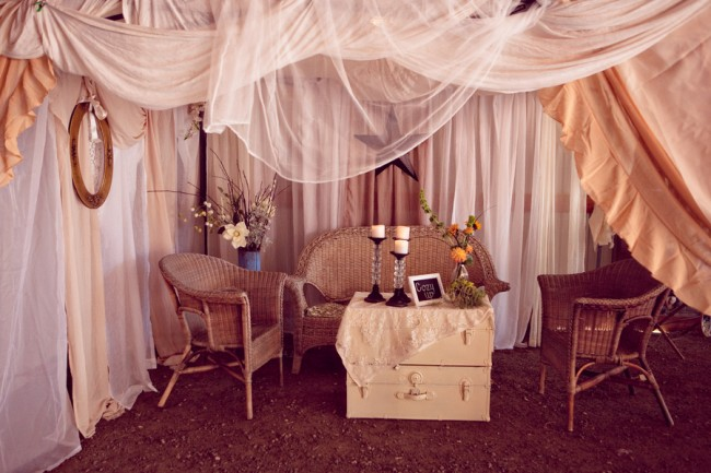 wicker chairs and old trunk with hanging curtains