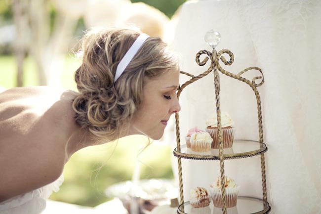 bride smelling cupcakes