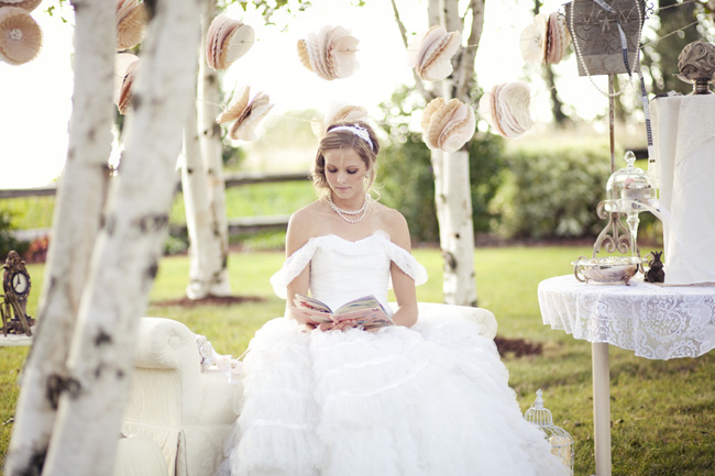 styled cinderella bride reading outdoors