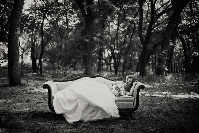black and white photo of bride on outdoor vintage couch
