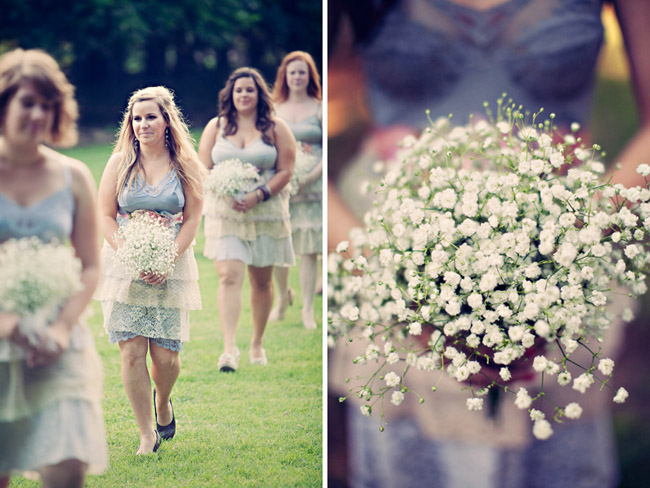 Bridesmaids walk with baby's breath bouquets