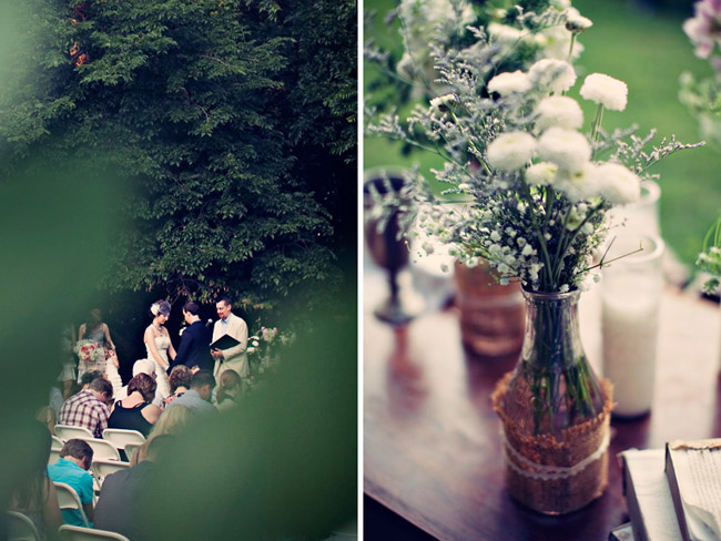 wedding ceremony view through trees; baby's breath and white flowers in vase on vintage table