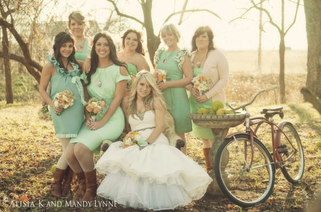 Burlap inspired bridal party in light green dresses with sunset backdrop