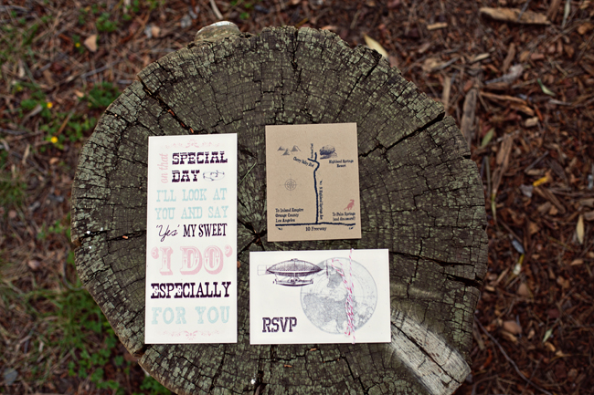 Whimsical DIY wedding invitations on tree stump
